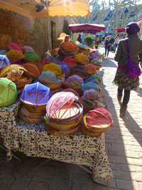 Colourful covers in Sarlat market